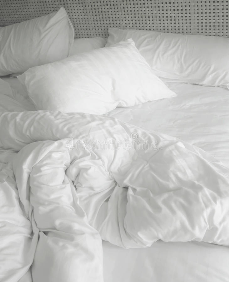 Messy bed sheets. Messy white bed sheets and pillow royalty free stock images