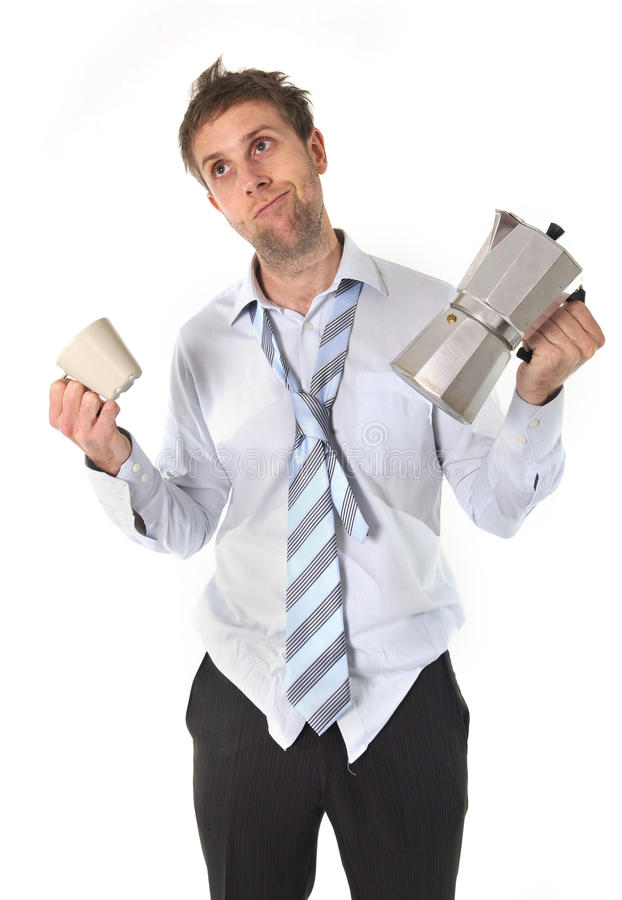 Messy business man with hangover holding coffee pot royalty free stock images