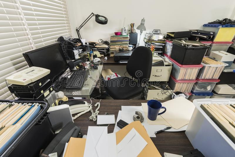 Messy Business Office with Piles of Files. And disorganized clutter royalty free stock photos