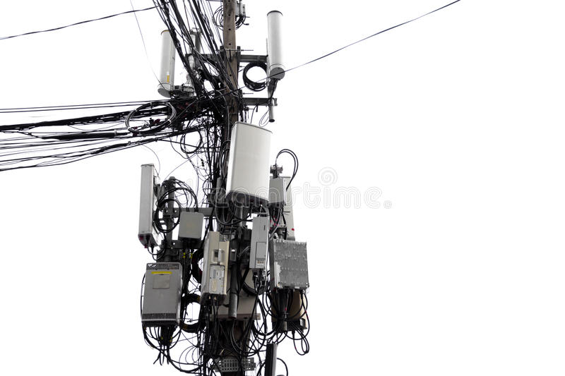 Messy cable distribution of transformer and electricity line on. Concrete pole isolated in white background royalty free stock photos