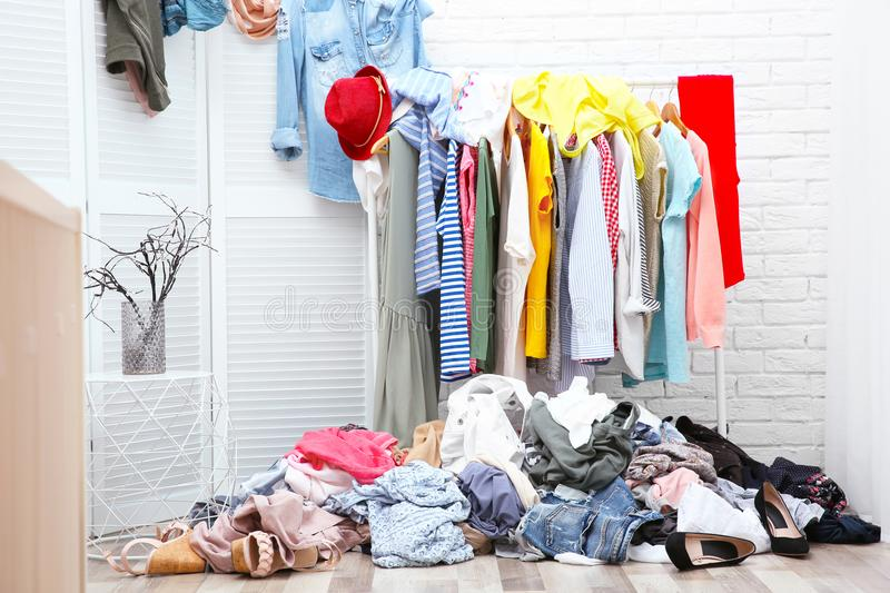 Messy dressing room interior with clothes royalty free stock images