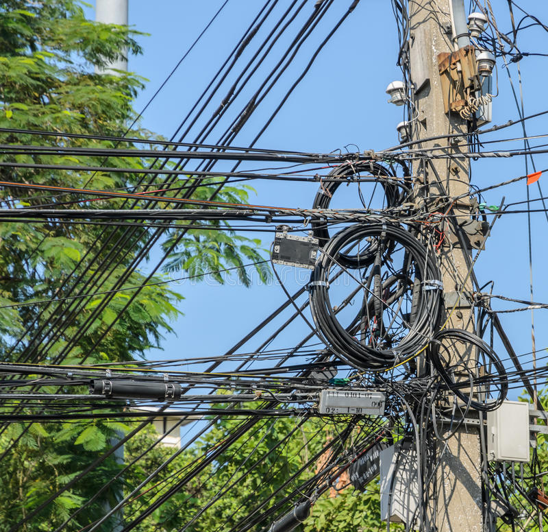 Messy electric cables on pole royalty free stock images