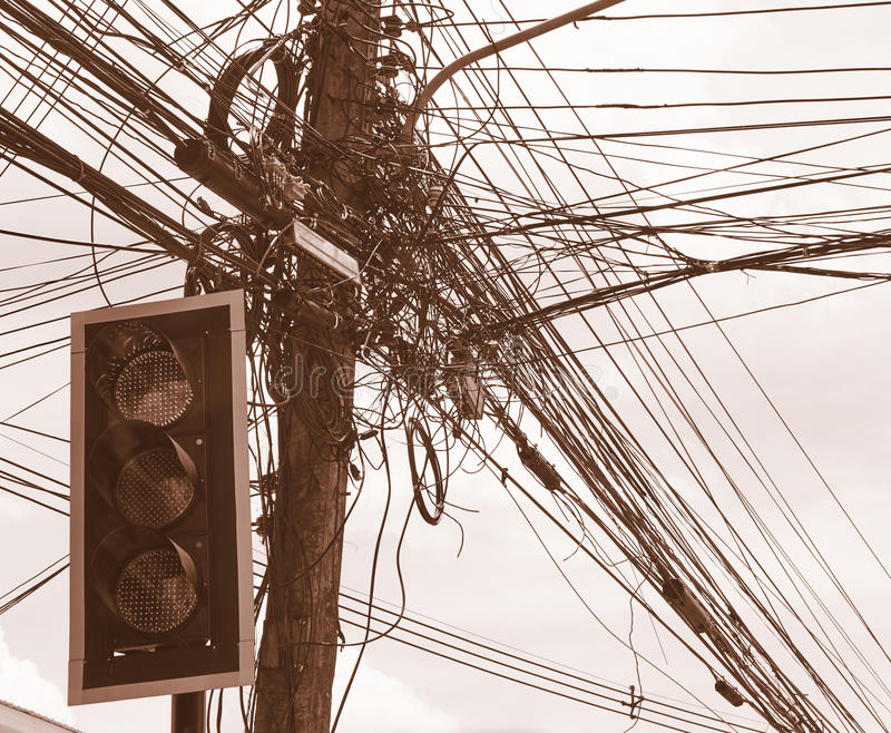 Messy Electrical Cables And Wires On Electric Pole In Front Of The ...