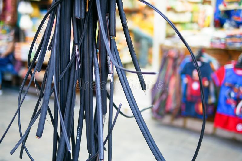 Messy electrical and telecommunication wire in Bankgkok, Thailand. Messy electrical and telecommunication wire is hanging on the pole in Bankgkok, Thailand royalty free stock photos