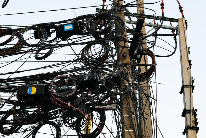 Messy electrical and telecommunication wire in Bankgkok, Thailand. Messy electrical and telecommunication wire is hanging on the pole in Bankgkok, Thailand royalty free stock images