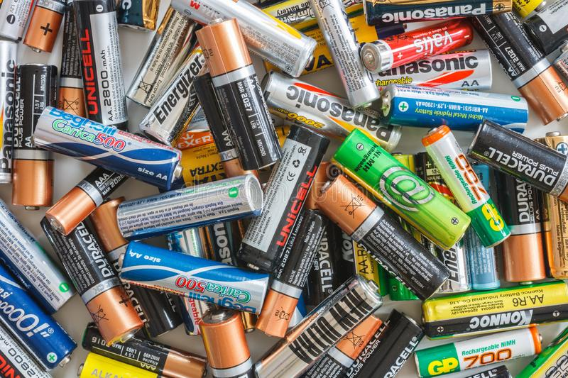 Messy group of used batteries stock images
