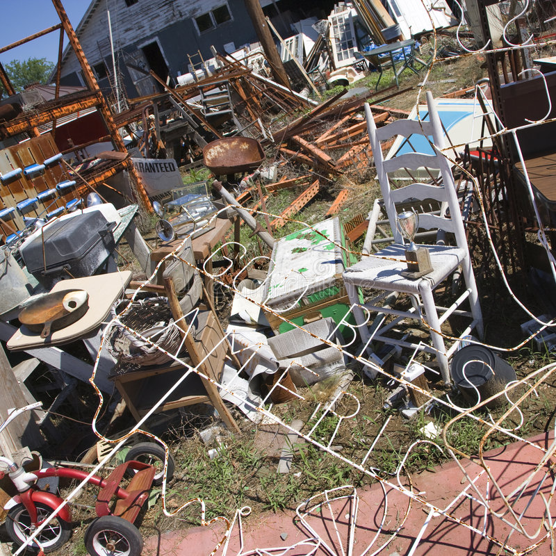 Messy junk in junkyard. Chaotic mess of junk strewn across junkyard outdoors royalty free stock photos