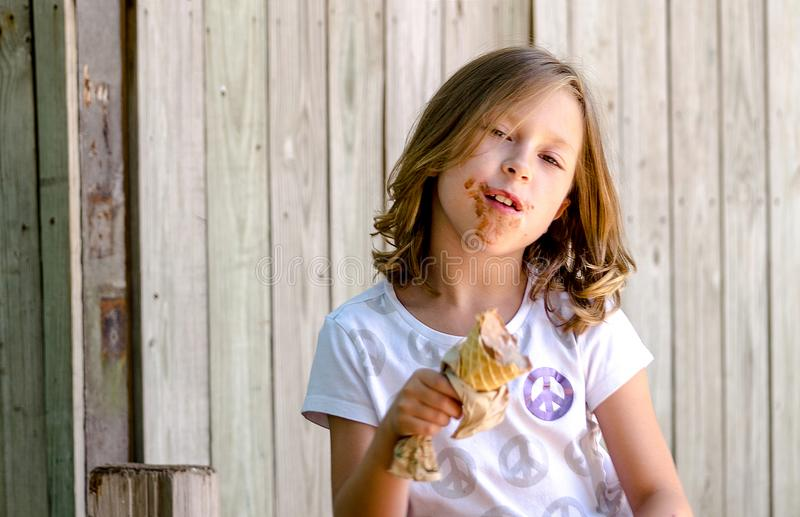 Messy little girl really enjoys ice cream royalty free stock image