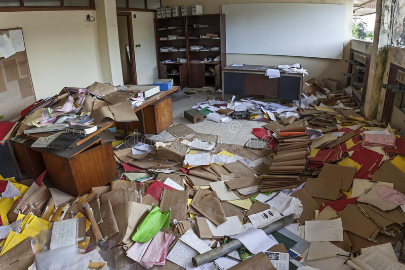 MESSY OFFICE FULL OF FOLDERS AND PAPERS. IN A TOTAL CHAOS royalty free stock image