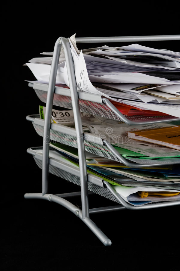 Messy paper tray with papers royalty free stock photography