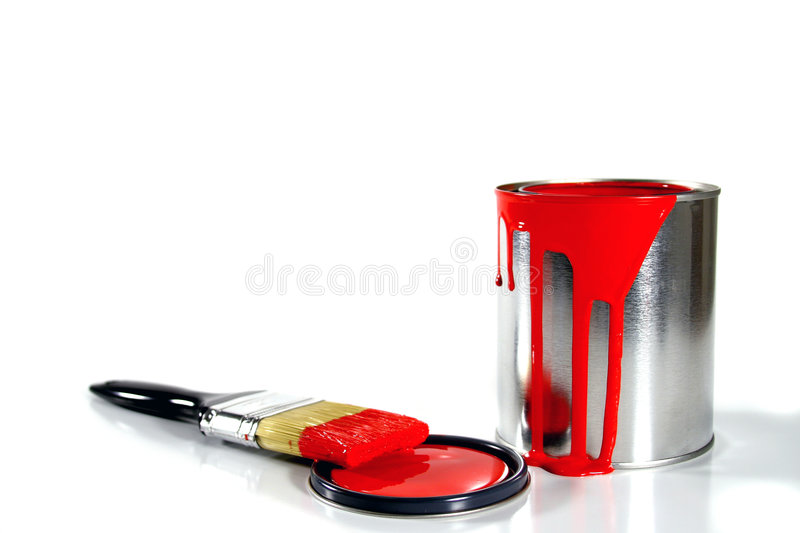 Messy red paint supplies. A messy red paint bucket and brush on white royalty free stock photos