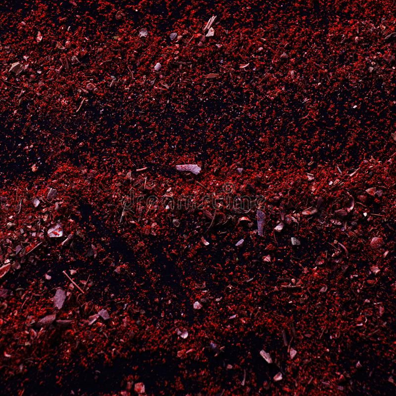 Messy spicy background. Spice texture. Close up top view. Variety of red spices on table, curry and herbs. National eastern cuisine royalty free stock photography