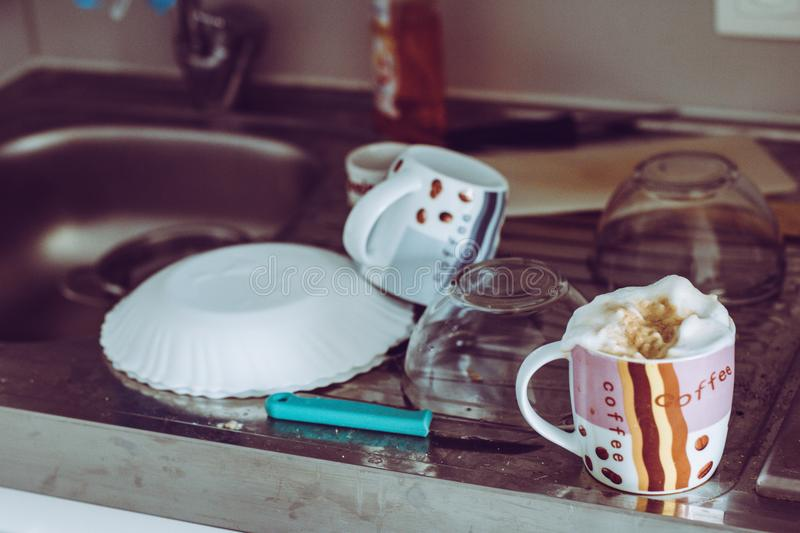 Messy student kitchen surface with coffee and dishes stock photography