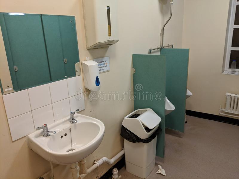 Messy toilet mens room stock photography