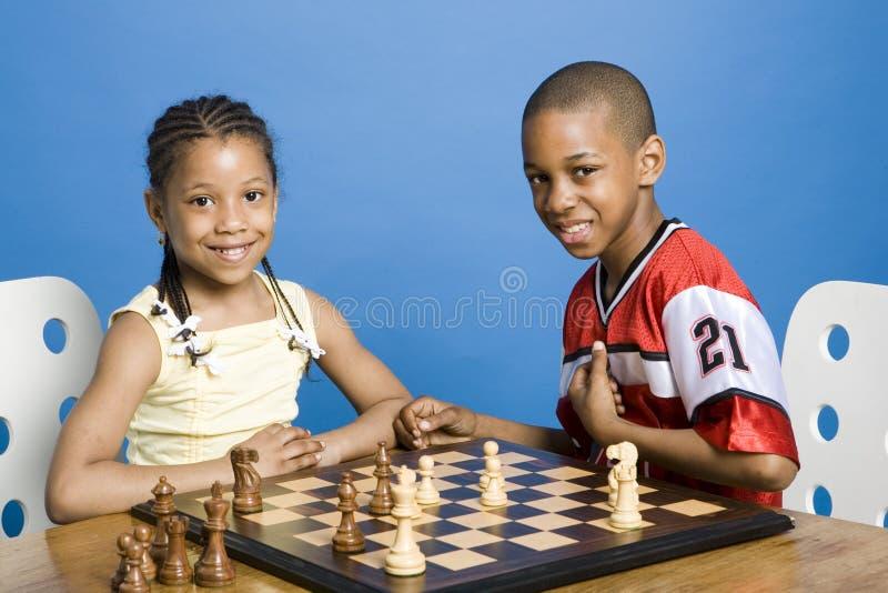 Mestres de sorriso da xadrez imagem de stock