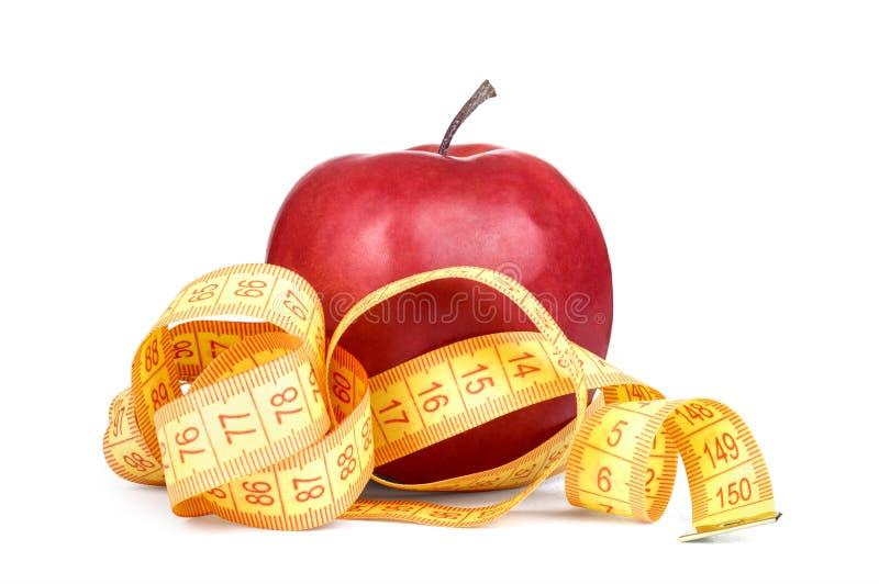 Mesure rouge de jaune de pomme photographie stock