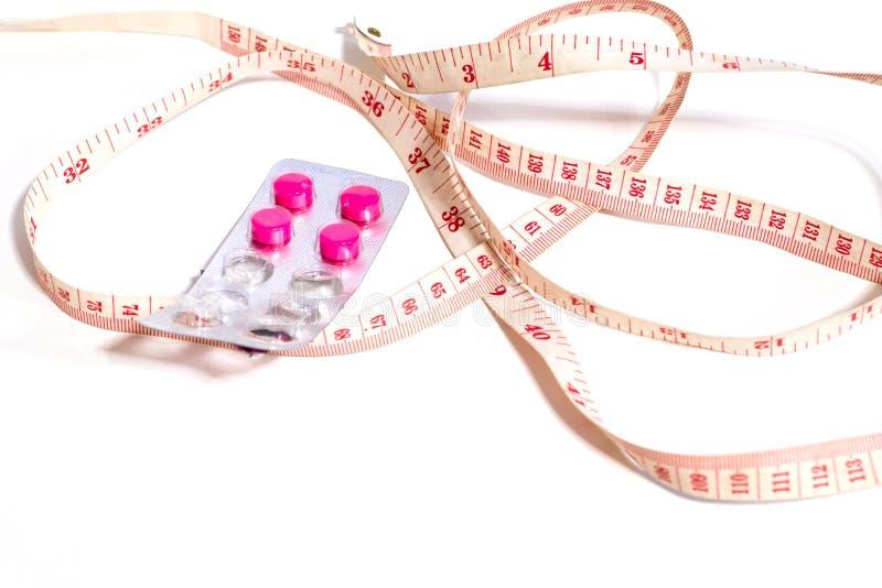 Mesurez la taille et les drogues de perte de poids images libres de droits