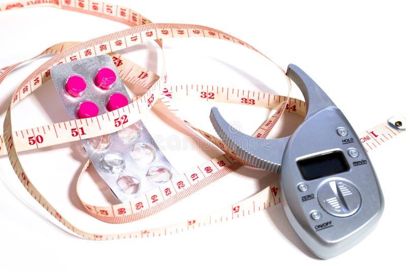 Mesurez la taille et les drogues de perte de poids photo libre de droits