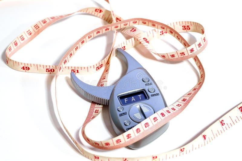 Mesurez la taille et les drogues de perte de poids photos libres de droits