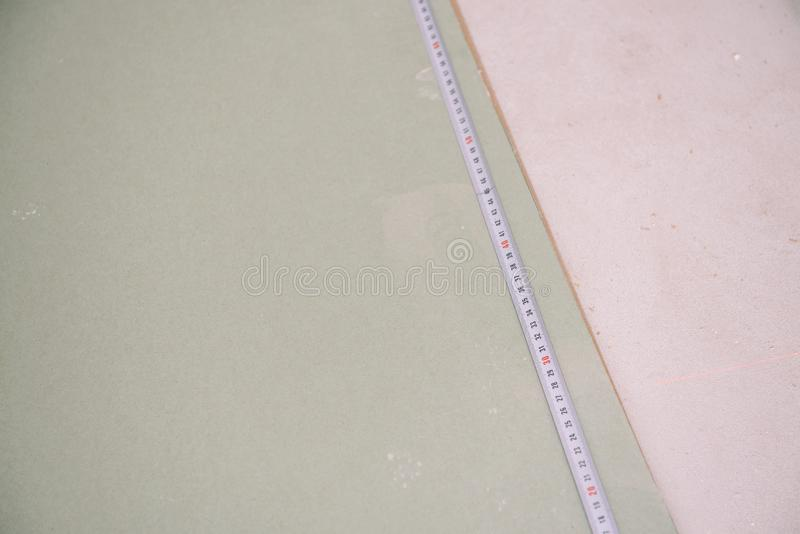 Mesurez la taille Mesure de Gypscortic Dessinez une taille Mastre mesure la longueur image stock