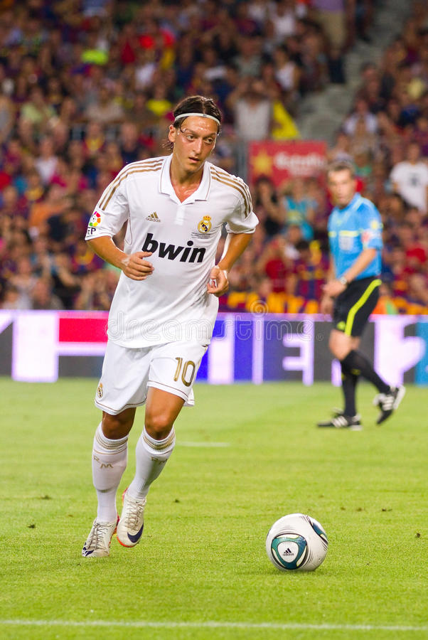 Mesut Ozil in action. BARCELONA - AUGUST 17: Mesut Ozil in action during the Spanish Super Cup final match between FC Barcelona and Real Madrid, 3 - 2, on August royalty free stock photo