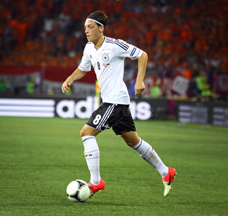 Mesut Ozil of Germany controls a ball. KHARKIV, UKRAINE - 13 June, 2012: Mesut Ozil of Germany controls a ball during UEFA EURO 2012 game against Netherlands stock photography