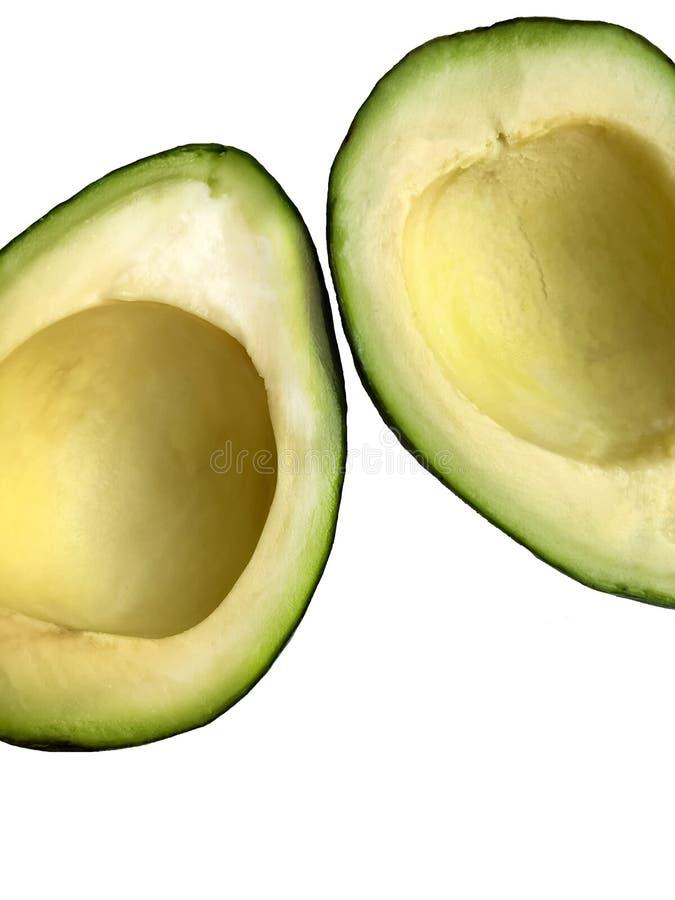 Metà dell'avocado isolate su fondo bianco fotografia stock libera da diritti