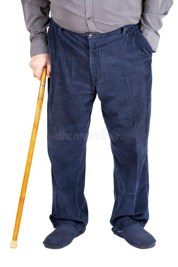 Metà dell'uomo anziano che cammina con la canna fotografia stock