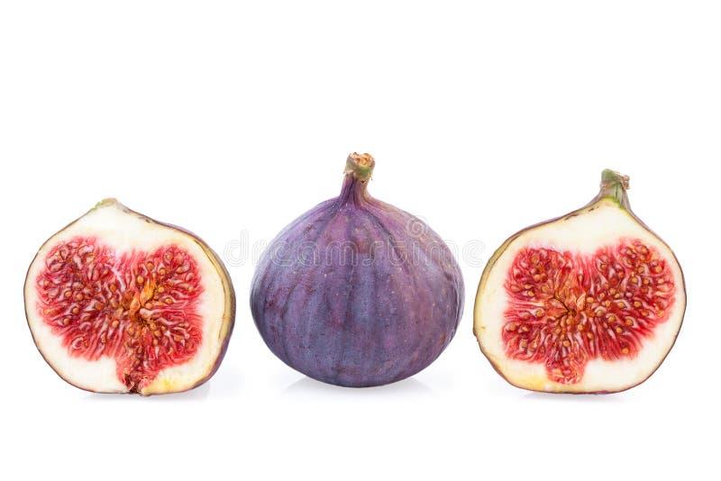 Metà della frutta dei fichi intere e due immagini stock