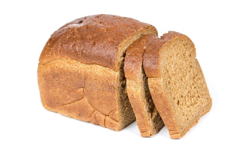 Metà di una pagnotta del pane di segale immagine stock