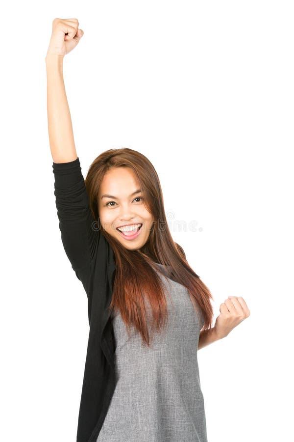 Metà incoraggiante di celebrazione sollevata pugno asiatico della donna immagini stock