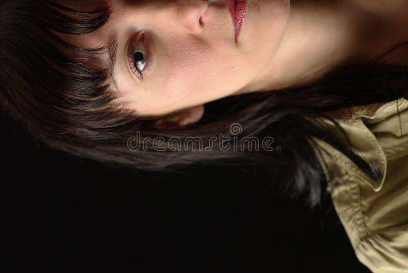 Metà-ritratto del fronte della ragazza fotografia stock