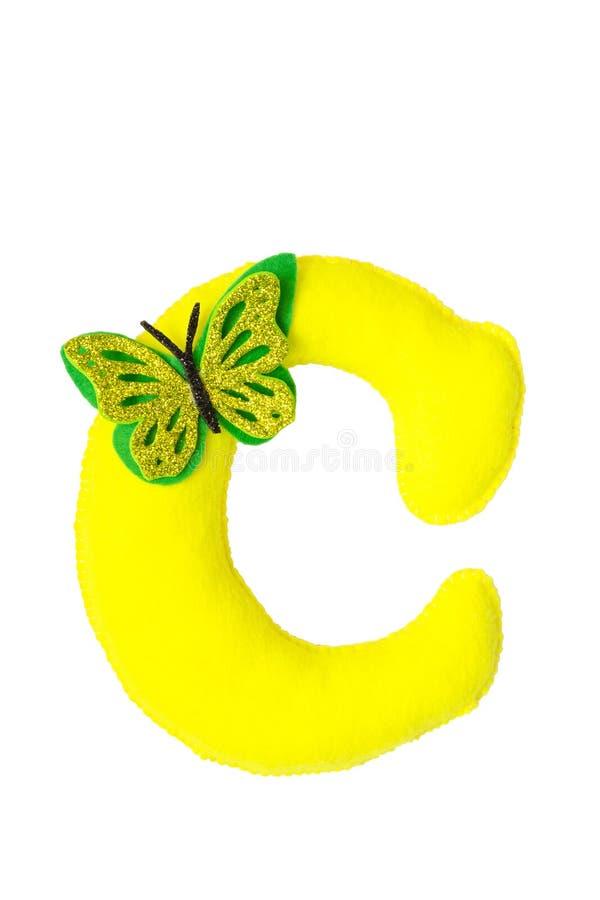 Met de hand gemaakte gele die brief C van gevoeld wordt gemaakt stock afbeeldingen