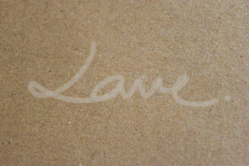 Download Met De Hand Geschreven ``-LIEFDE `` Op Pakpapier, Prachtig Eenvoudige Stijl Stock Foto - Afbeelding bestaande uit lesbienne, decoratie: 107707088