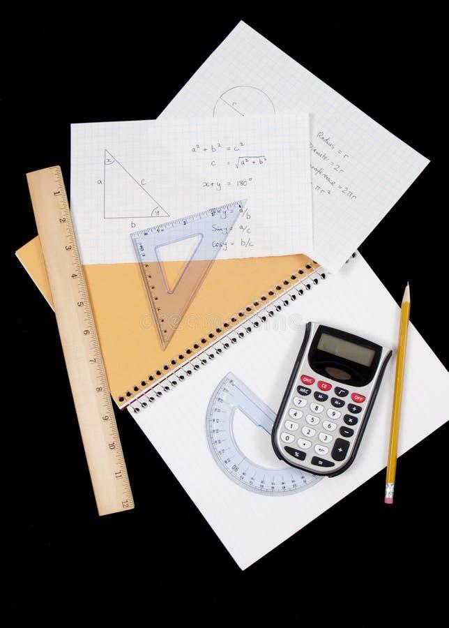 Met de hand geschreven mathproblemen en instrumenten royalty-vrije stock foto's