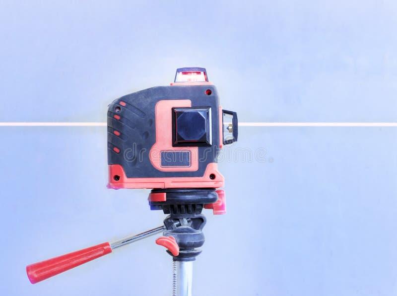 Met een laser bij de bouwwerf Close-up royalty-vrije stock afbeeldingen