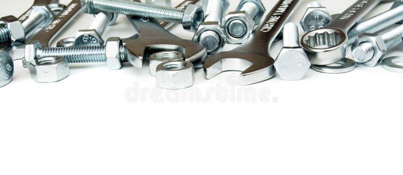 metaalbewerking Metaalinrichting, moersleutel op een wit stock afbeelding