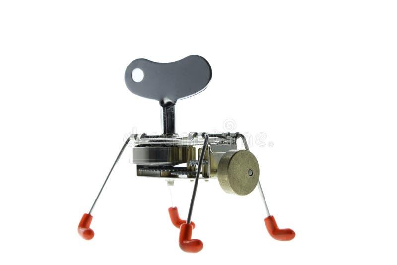 Metaalrobot met rode voeten aan kabel in verschillende posities stock fotografie