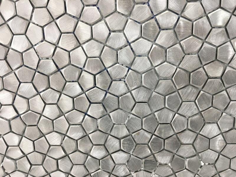 Metaalroestvrij staaltegel in een Geometrisch Patroon stock afbeeldingen