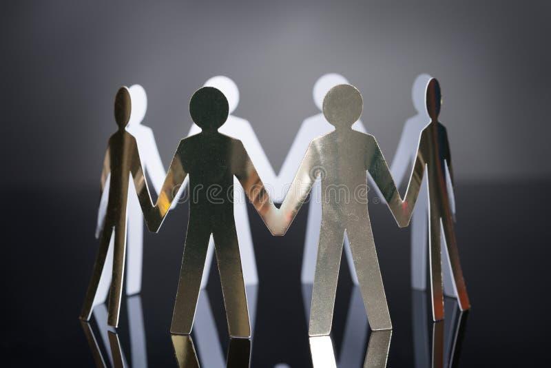 Metaalteam die eenheid vertegenwoordigen stock afbeelding