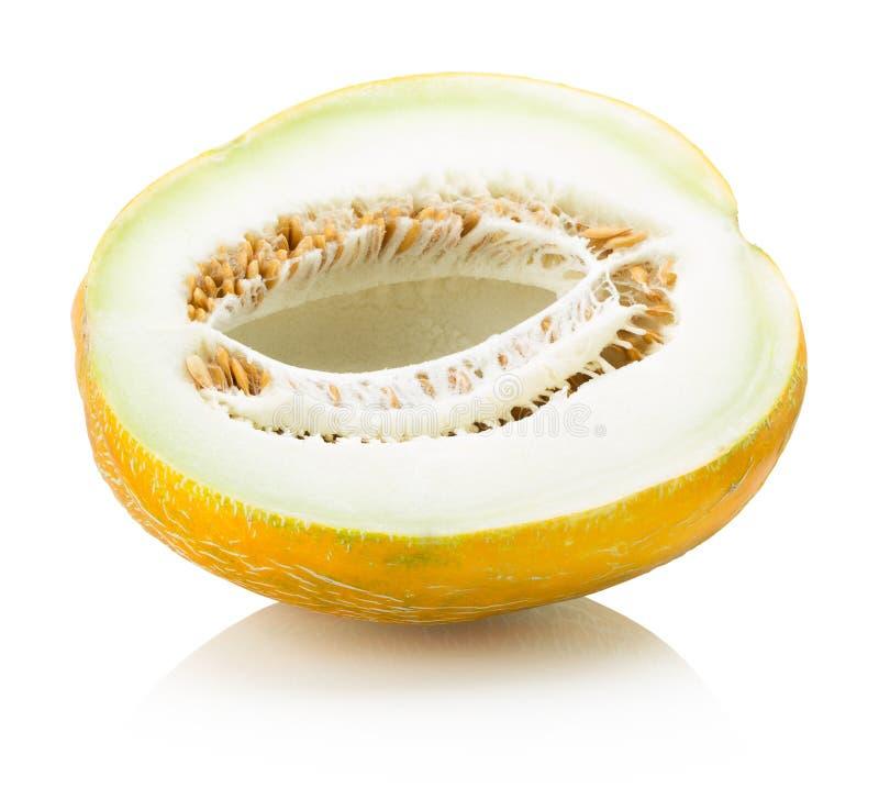 Metade do melão isolada no fundo branco imagem de stock
