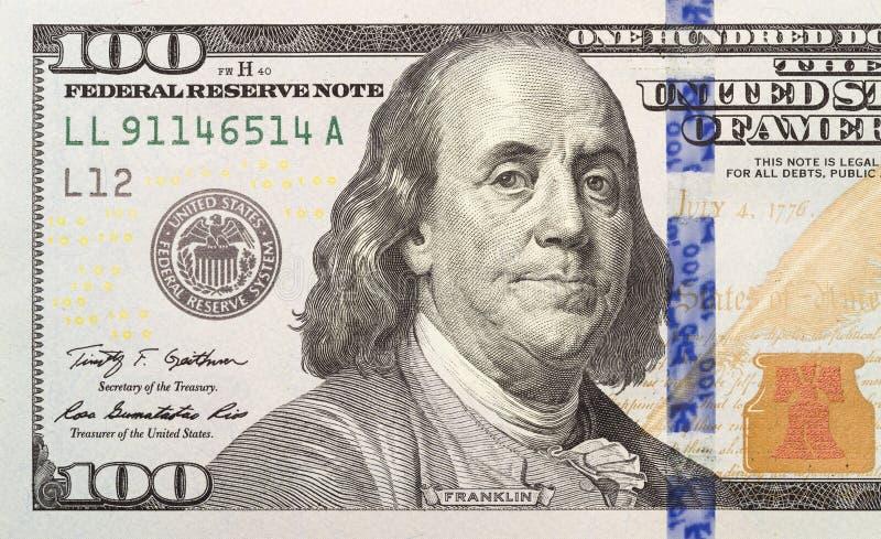 Metade esquerda da nota de dólar do novo cem fotos de stock royalty free