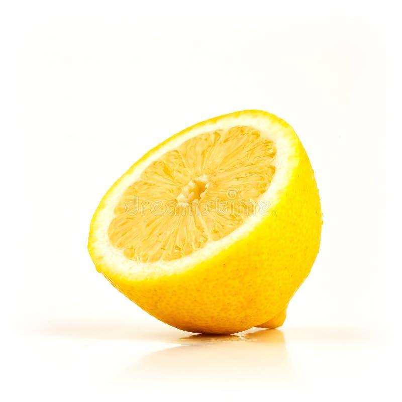 Metade fresca do limão no branco fotografia de stock royalty free