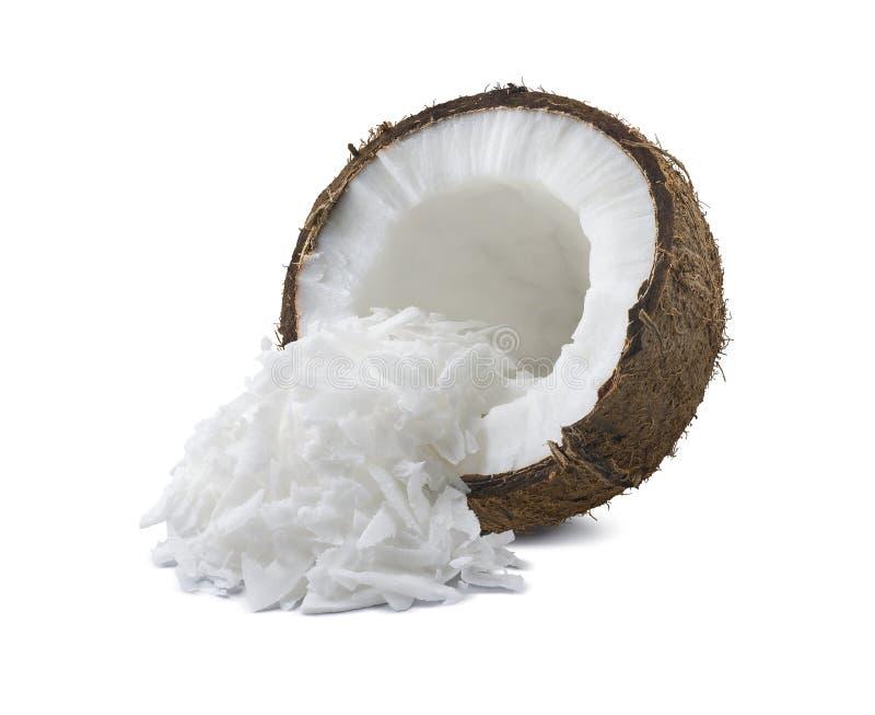 A metade quebrada coco shredded isolado no fundo branco imagens de stock royalty free