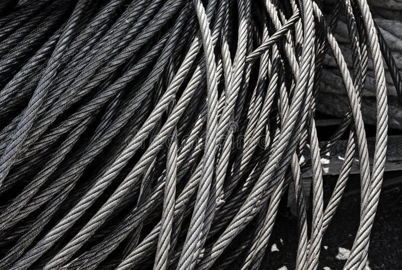 Metal скороговорки текстуры стальных шнуров металла кабеля в концепции индустрии и выпуска облигаций стоковые фото