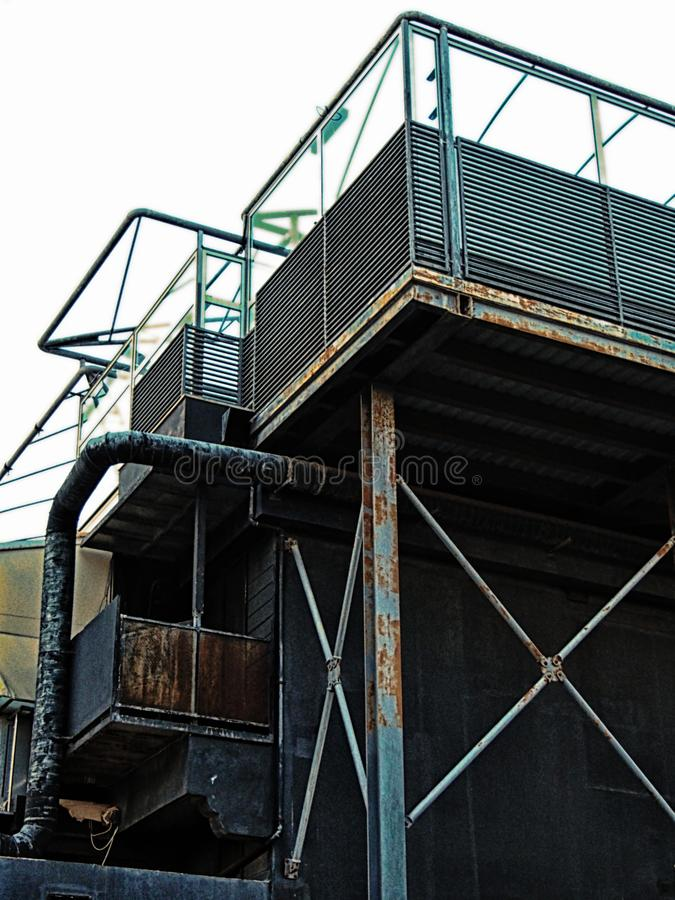 Abandoned derelict industrial building with rusting steel girders tanks and pipes royalty free stock images