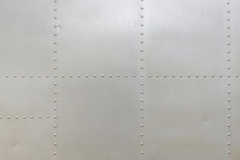 Metal aluminum surface of the aircraft fuselage texture.  stock image