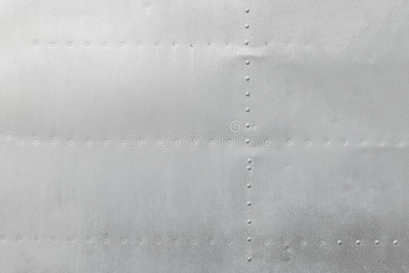Metal aluminum surface of the aircraft fuselage texture royalty free stock photography