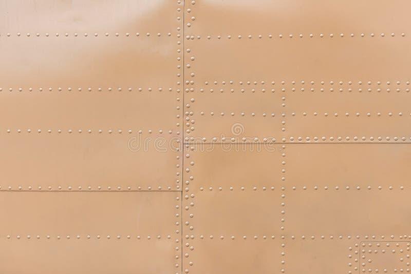Metal aluminum surface of the aircraft fuselage texture.  stock photos