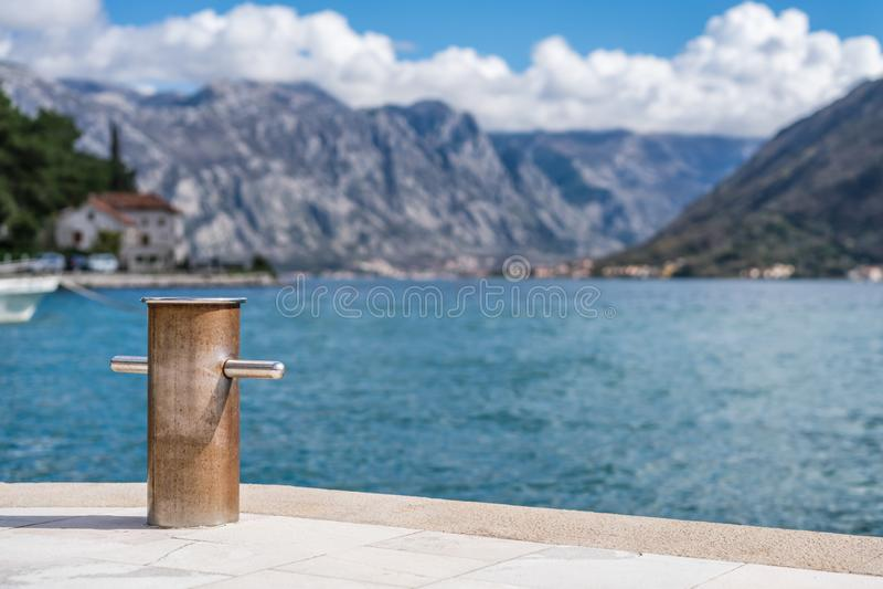 Metal anchoring bollard in Perast. Steel anchoring bollard on the shore in the beautiful Perast town in the Kotor Bay, Montenegro stock photo